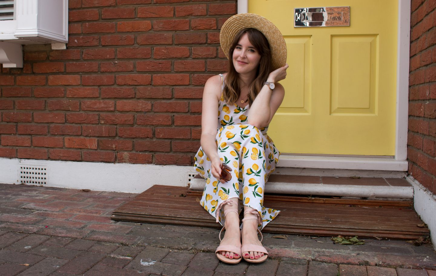 Lemon print dress and straw hat, both from ASOS